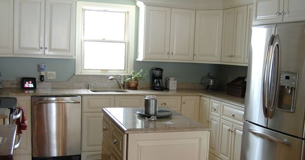 This Cozy Island Shaped Transitional Kitchen Layout Features Off White Cream Colored Cabinets
