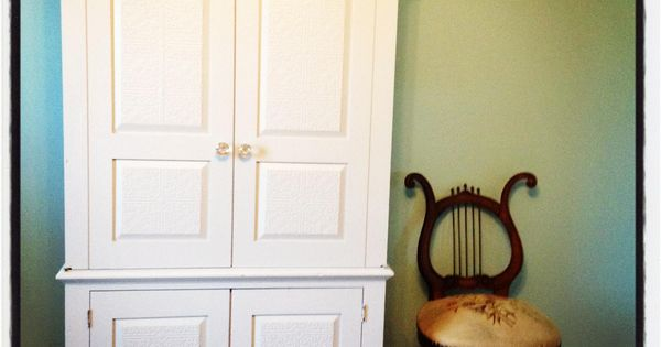 Armoire makeover by Girl in the Garage using ModPodge, paint, wallpaper and