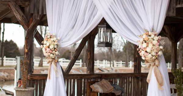 Draping entrance, tied with burlap and flowers in wedding colors. Sarah Marie Photography Via The Enchanted Florist barnwedding barndecor