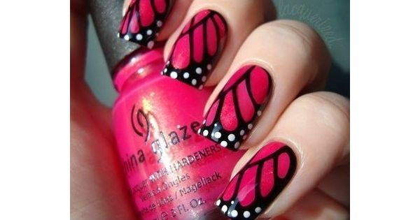 Pink butterfly wing nail design