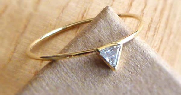 A whisper thin band paired with a triangular stone makes a modern