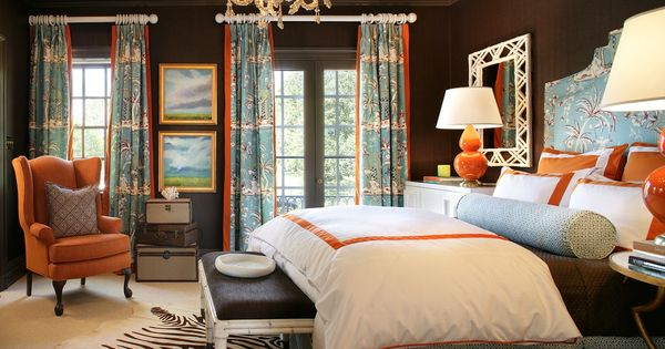 master bedroom - orange, white and accent with pattern curtains/ zebra rug