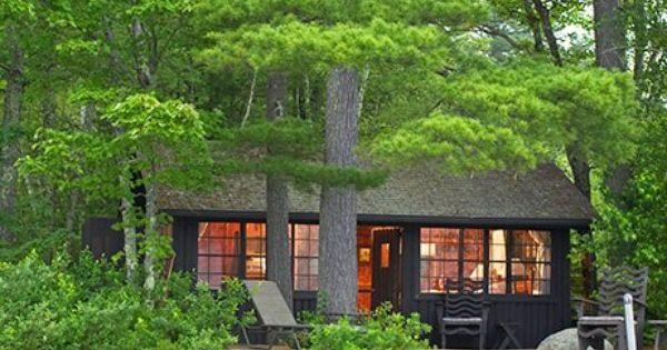 The 35 homey wood-paneled cottages of Migis Lodge are nestled amid 125