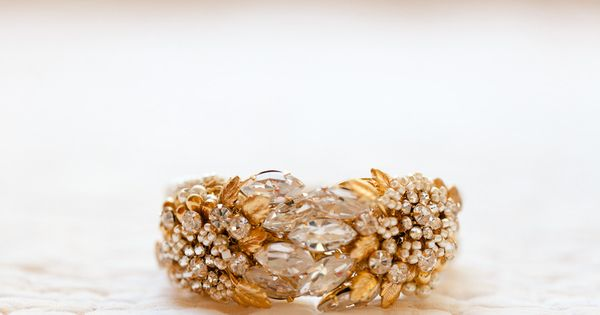 Bracelet by Miriam Haskell -- bride RENTED thru RentTheRunway.com. - great idea,