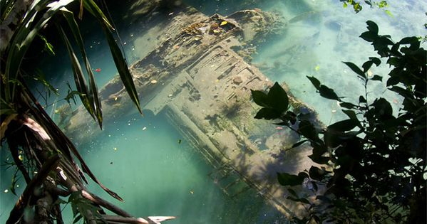 Photograph by Tony Cherbas showcases a fallen World War II Japanese seaplane