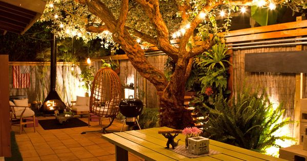 Garden lights aglow. The couple has designed the yard for entertaining. But