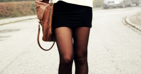 White sweater paired with a black skirt, black circle scarf and black
