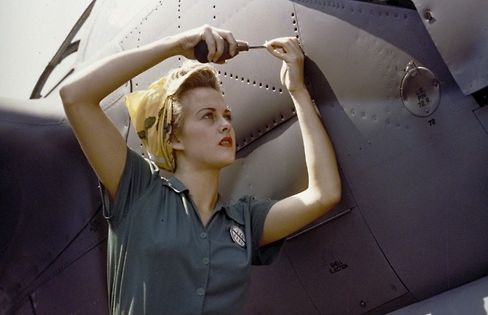 Sally Wadsworth working on a Lockheed P-38J airplane. - WWII propaganda photo,