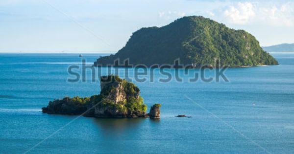 Small Rock Island And Blue Ocean By Chalermsak Via Shutterstock