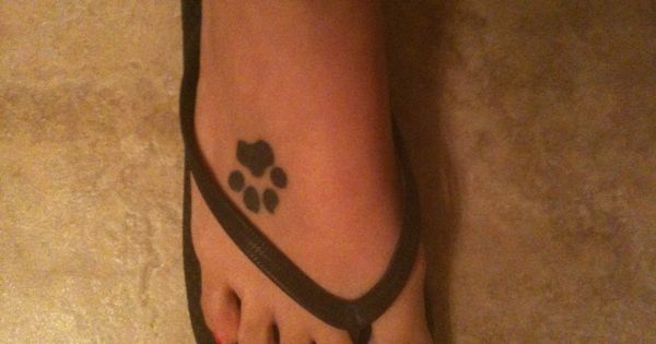 Paw Print Tattoo on foot because bud always steps on feet :)