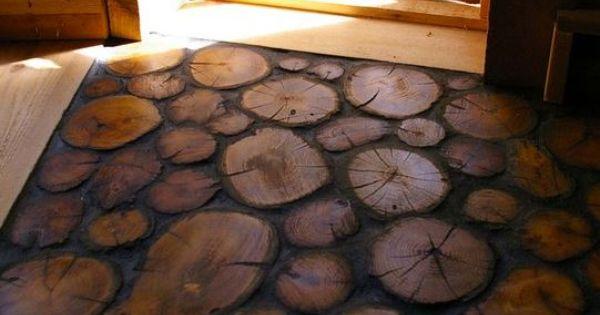 "Wood slice ""tiles"" make a perfect entry for a house or cabin"