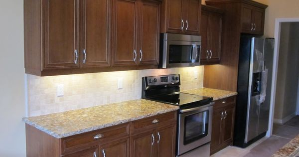 This transitional straight line kitchen layout features for Kitchen cabinets 50 off