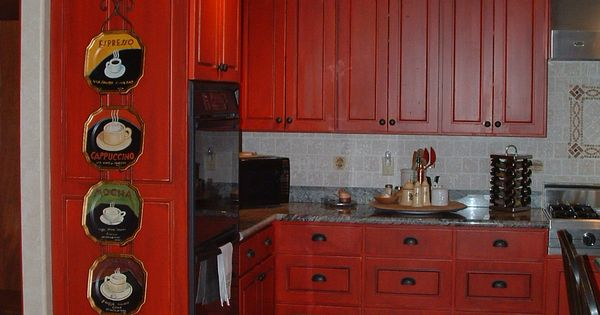 Bright red distressed cabinets with black accent glaze for Bright red kitchen cabinets