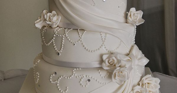 Beautiful wedding cake..... You can add your colors to the roses, or whatever flowers you like! The draping could be burlap!
