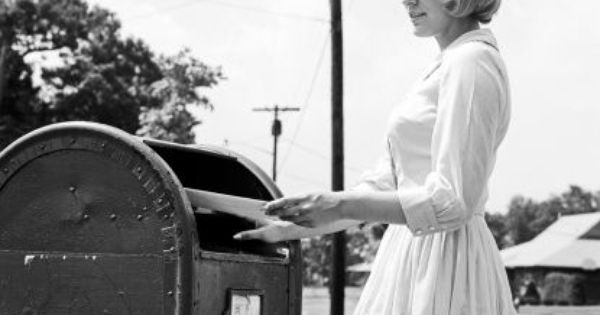 Young Woman Putting Letters In Us Mail Letter Box Therese