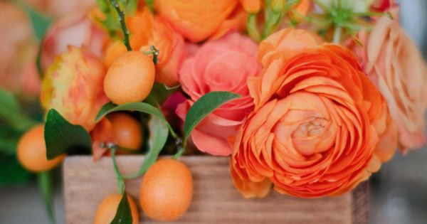 bright orange centerpieces with the loveliest kumquat accents Photography by troygrover.com/, Wedding