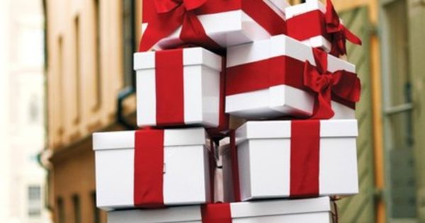 white christmas gift box presents with red ribbon
