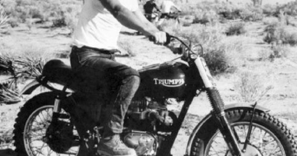"""Actor Steve McQueen and his Triumph desert bike in their native habitat."""