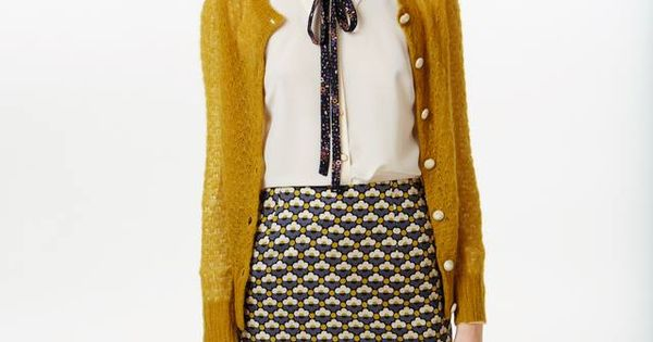 Ensemble by Orla Kiely--mustard cardigan over white blouse with a patterned bow