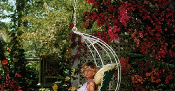 Pretty amazing hanging chair! Barbados Bliss by Slim Aarons, 1976