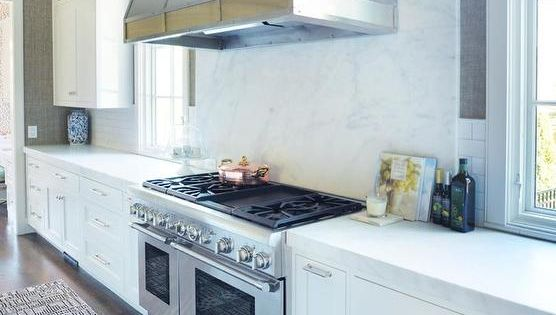 Marble cooktop backsplash kitchens pinterest for Textured wallpaper backsplash