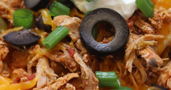 Slow cooker Nacho Chicken - 2-4 chicken breasts, 2-3 cans diced tomatoes,
