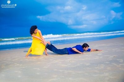 Funny Pre Wedding Photo Shoot By The Beach Dressed In Smart Casual