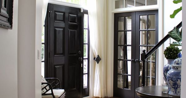 not sure about black doors in entry. TiffanyD: Foyer changes... Adding privacy,