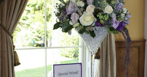 Purple wedding flower centrepieces by flourish to hire silk flowers Devon and