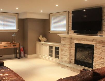 Cozy Basement Love The Lighting Built In With Fire Place In Middle