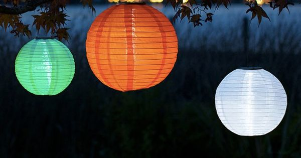 The accordion-style lanterns and string lights are made from nylon so the vibrant colors will ...