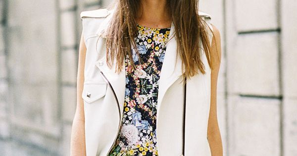 Try a white leather vest paired with a bright floral romper. This