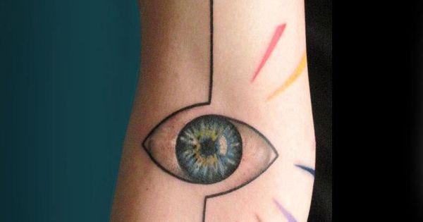 Minimal line graphics eye tattoo on arm by greek tattoo ...