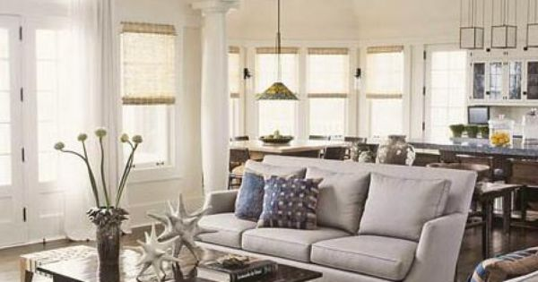 Thom filicia neutral grey living room with pops of blue for Neutral gray living room