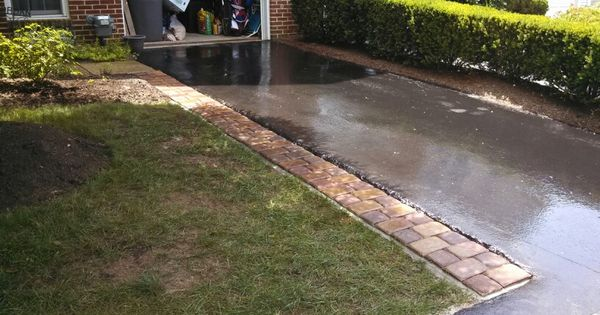 Decorative paver driveway extension using concrete base Base for concrete driveway