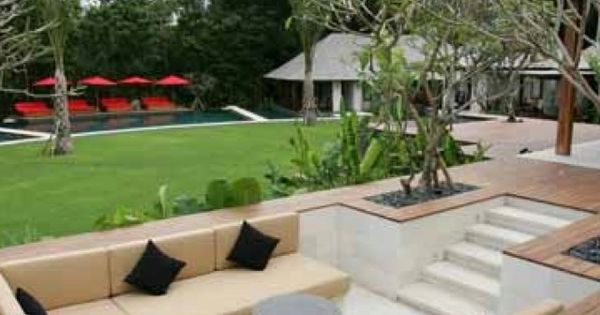 Sunken cabana with throw cushions at end of garden for Sunken outdoor seating