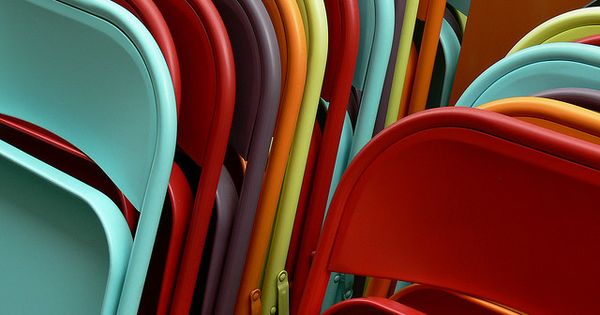 spray paint old metal folding chairs. LOVE!....I am so doing this