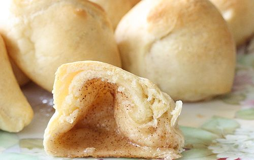 Marshmallows dipped in melted butter, then cinnamon sugar, wrapped in crescent rolls