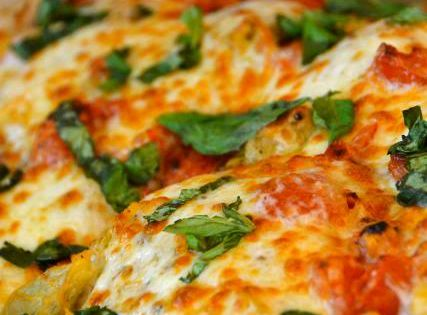 Italian Chicken; Fresh, ripe Roma tomatoes, artichokes, cheeses and basil baked over