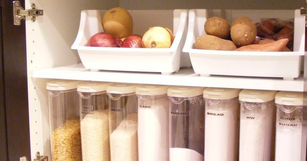 Use cereal containers to house your baking supplies neatly away. Kitchen Organization