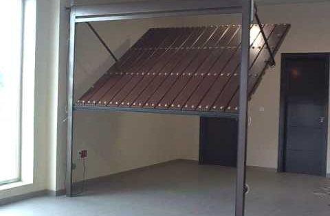 Puerta automatica basculante no desbordante puertas for Puerta automatica no abre