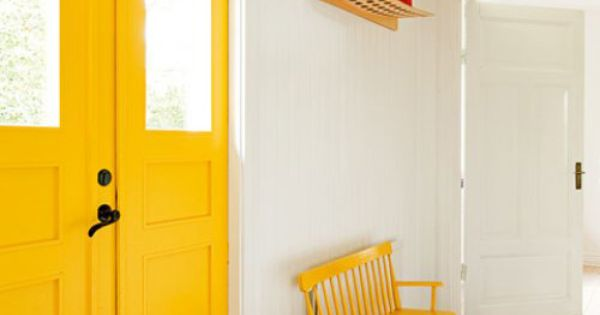 Entry Way...love the bright yellow on the inside of the door. Would