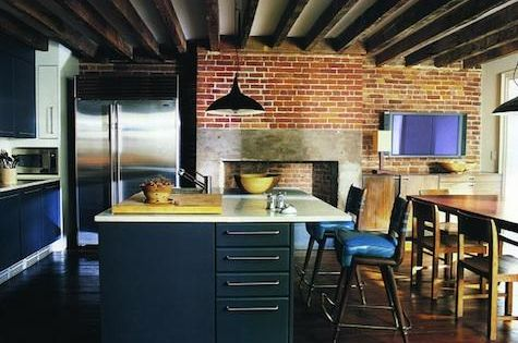 dark cabinets, dark floors, wood beams, exposed brick