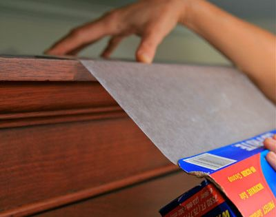 Place a layer of wax paper on top of kitchen cabinets where