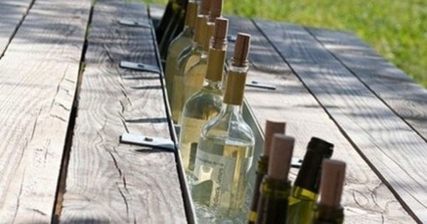 Replace one board of the picnic table with gutter's for a built
