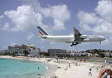 Saint Martin Yes The Airport Is Very Close To A Beach Saint Martin Island Caribbean Travel Sint Maarten