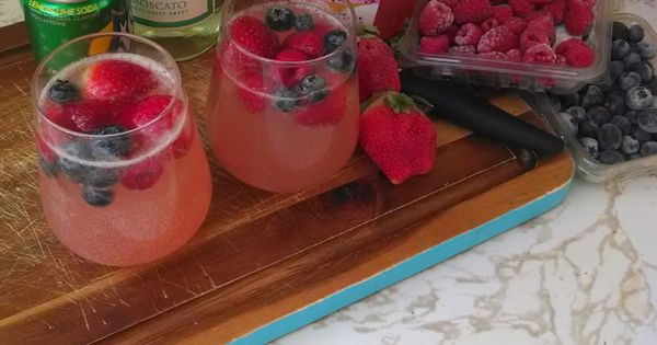 Moscato wine punch, its a super delish Summer cocktail. So when 5 o'clock rolls around get those car keys and rush home for the super wonderful cocktail. Peace and Love. --Lizzy xoxo