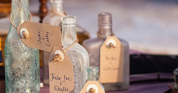beautiful sea glass colored bottles that double as seating cards Photography by