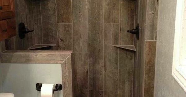 A Beautiful Rustic Shower With Tile That Looks Like Wood