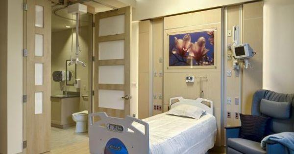 A wide bathroom door opening and patient lift ease patient for Bariatric bathroom design